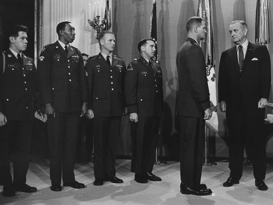President Lyndon B. Johnson presents Medal of Honor to Captain Angelo Liteky, USA. Also present from left to right, fellow Medal of Honor recipients Specialist-4 Gary Wetzel, Specialist-5 Dwight H. Johnson, Sergeant Sammy L. Davis, Captain James A. Taylor.