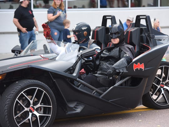 Batman and Captain America attend the Independence