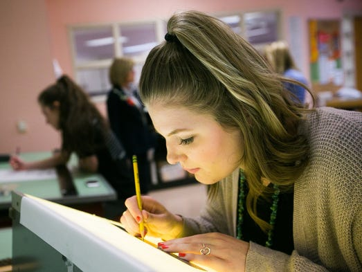 McKenzie Dickman, 18, works on a interior design during