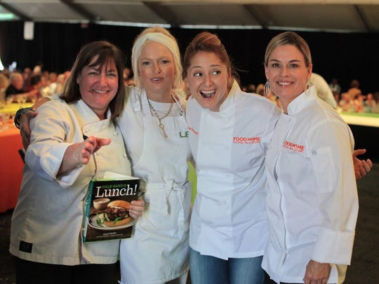 (From the left) Chefs Gale Gand, Lulu Powers, Brooke Williamson and Cat Cora pose for photos at James Beard Luncheon in Palm Desert on Friday.