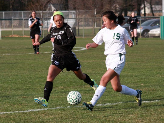 Pennfield's Leah Tharp tries to get the ball past Lakeview's