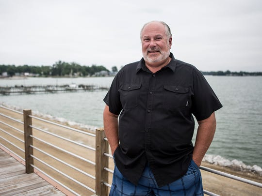 Mike Fornataro, Executive Director of Buckeye Lake Region Corporation, poses for a portrait in front of Buckeye Lake.
