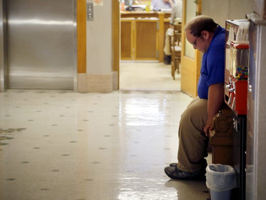 Eric Meyer, 30, of Lake View sits forlornly in a Calhoun County Courthouse hallway after pleading guilty to three misdemeanors last Tuesday — failure to have proof of insurance, failure to wear a seatbelt and unsafe passing. Meyer struck bicyclist Shawn Gosch and propelled him into fellow cyclist Jeff Gray on Iowa Highway 7 on June 20. Gosch was killed and Gray was seriously injured.