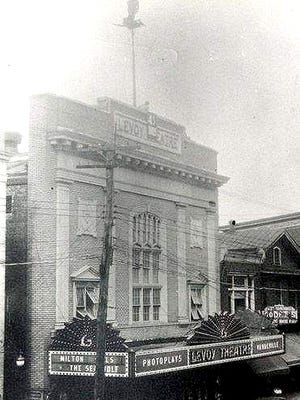 "Henry ""Had"" Elliott is seen on his lonely perch atop Millville's Levoy Theatre during October 1930."