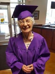 Madeline (Watzka) Buehler's graduation photo taken by her family in 2017.