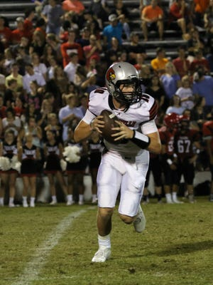 Adamsville's Colin Misenhiemer (10) looks to pass the ball against Lexington on Friday in the jamboree.