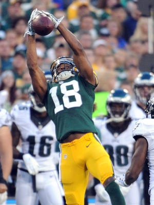 Green Bay Packers receiver Randall Cobb (18) jumps for ahigh pass against the Philadelphia Eagles at Lambeau Field August 29, 2015.