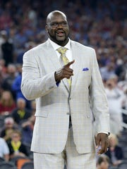 Shaquille O'Neal poses on the court as the Naismith Memorial Basketball Hall of Fame 2016 Class is announced.