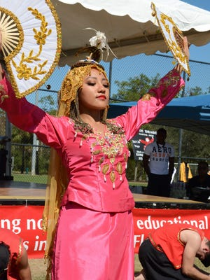Kristina Biglete performs as the princess in a Filipino folk dance. Asia Fest, held last Saturday at North Collier Regional Park to coincide with Chinese New Year, showcases a variety of Asian cuisine, vendors, and cultural performances.