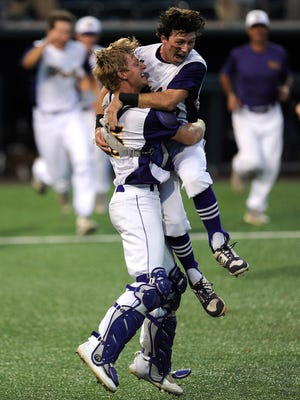 Wylie catcher Caleb Munton (25) celebrates with teammate Zach Smith (39) after the final out of the Bulldogs' 6-5 win over Robinson in the Class 4A state championship game on Thursday, June 8, 2017, at Disch-Falk Field in Austin.