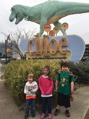 Connor Cater, 4; Clara Cater, 6 and Sheldon Hale-Carpenter, 7, visit cMoe. Lindsay Cater said she was pleasantly surprised to see the children's museum had earphones for children who may have sensory sensitivities and hopes to see other businesses follow suit.
