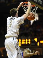 Vanderbilt forward Luke Kornet (3) dunks the ball as