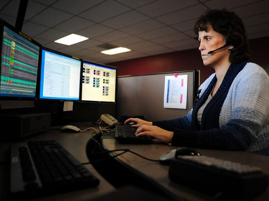 Corey Henderson takes a 911 call at the dispatch center, on Wednesday, March 25, 2015, in Salem. Henderson is retiring after a nearly 32-year career with Willamette Valley Communications.
