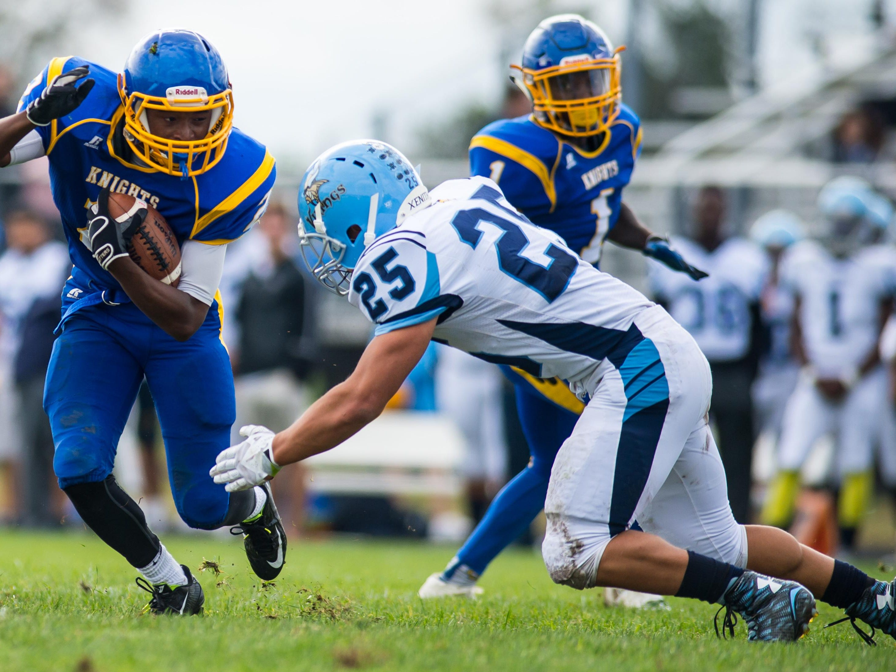 Sussex Central running back Kendrick Nocks (2) rushes against Cape Henlopen at Sussex Central.