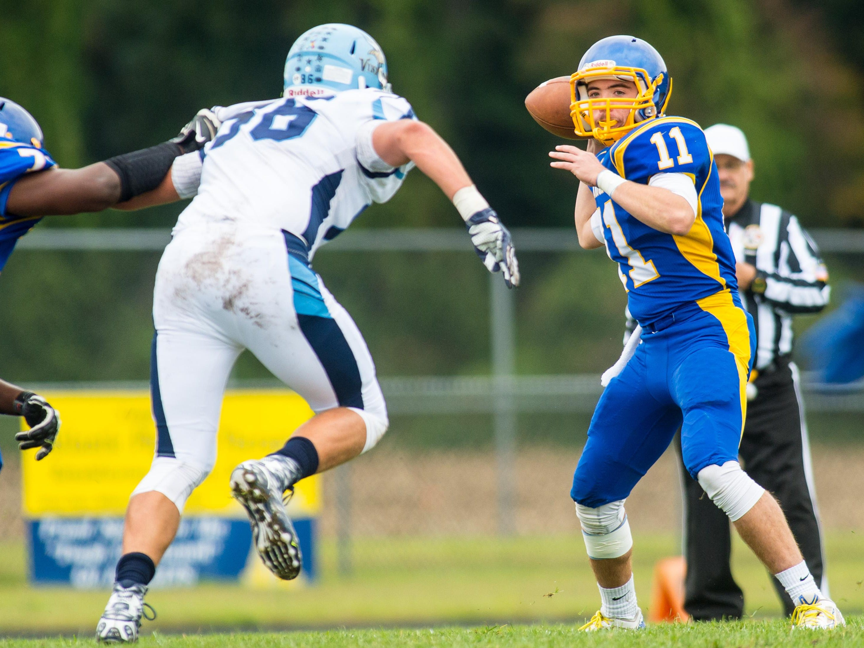 Sussex Central quarterback William Wells (11) drops back for a pass against Cape Henlopen at Sussex Central.