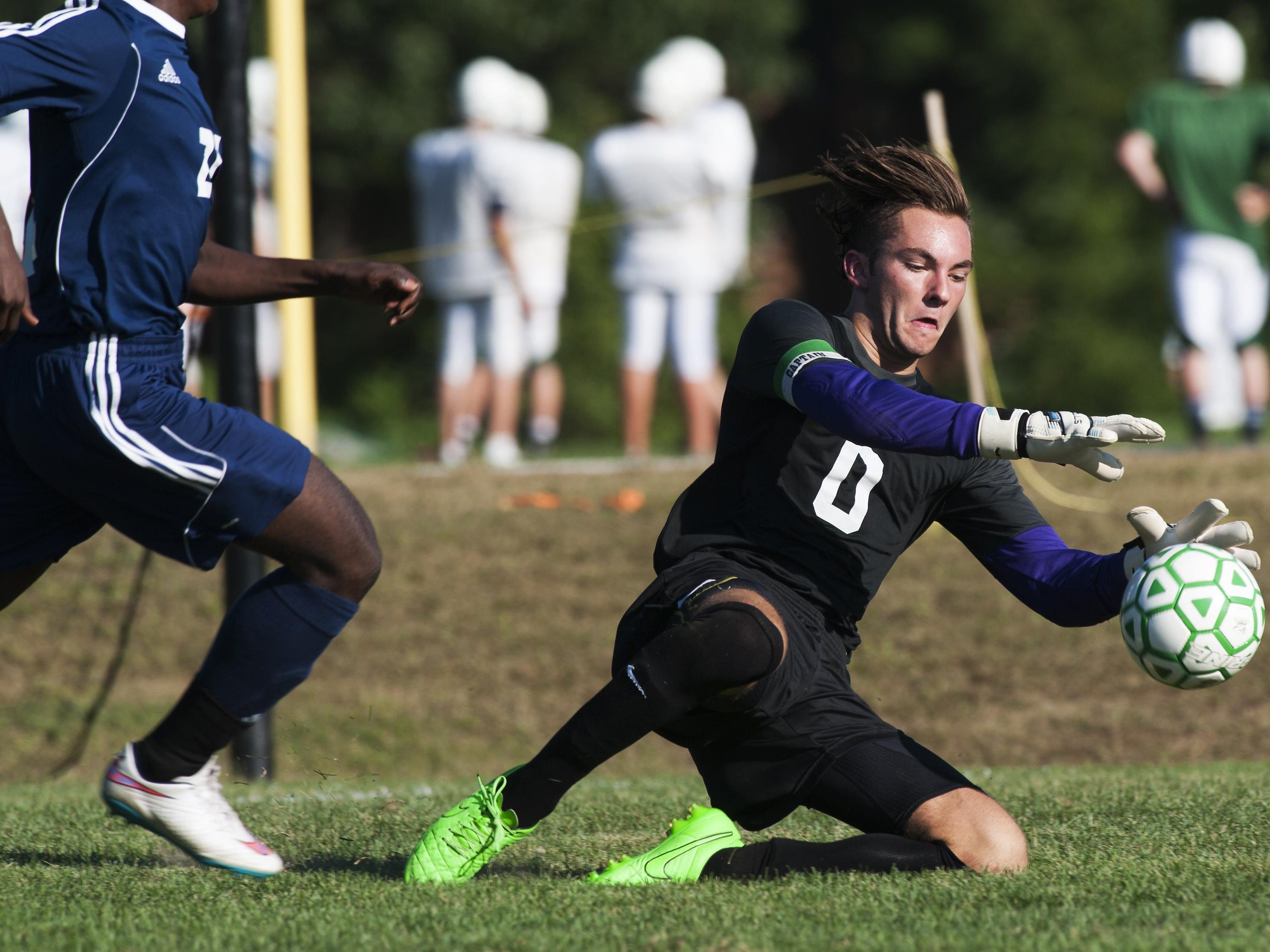 Rice goalie Leland Gazo (0) makes a save during the boys soccer game between the Burlington Seahorses and the Rice Green Knights earlier this season.