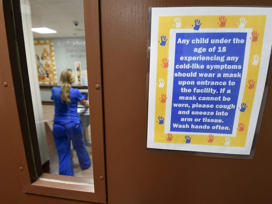 A nurse works in the Women & Newborn Care Center at Baxter Regional Medical Center in Arkansas. Signs, like the one at the entrance to the center, have been placed around the hospital in light of the enterovirus D68. Middlesex County released a fact sheet to the parents of public school children on Sept. 29 to help them prevent the spread of the virus.