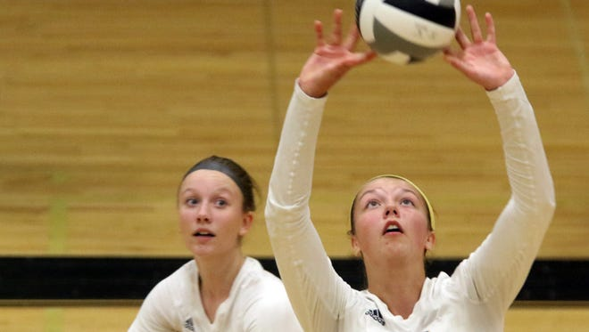 Franklin's Brianna Merkel (front) and Kaitlyn Gawelski work a play in a match last year. After winning the Southeast Conference tournament last season and making the sectional semifinal, the Sabers bring back a ton of talent in 2017.