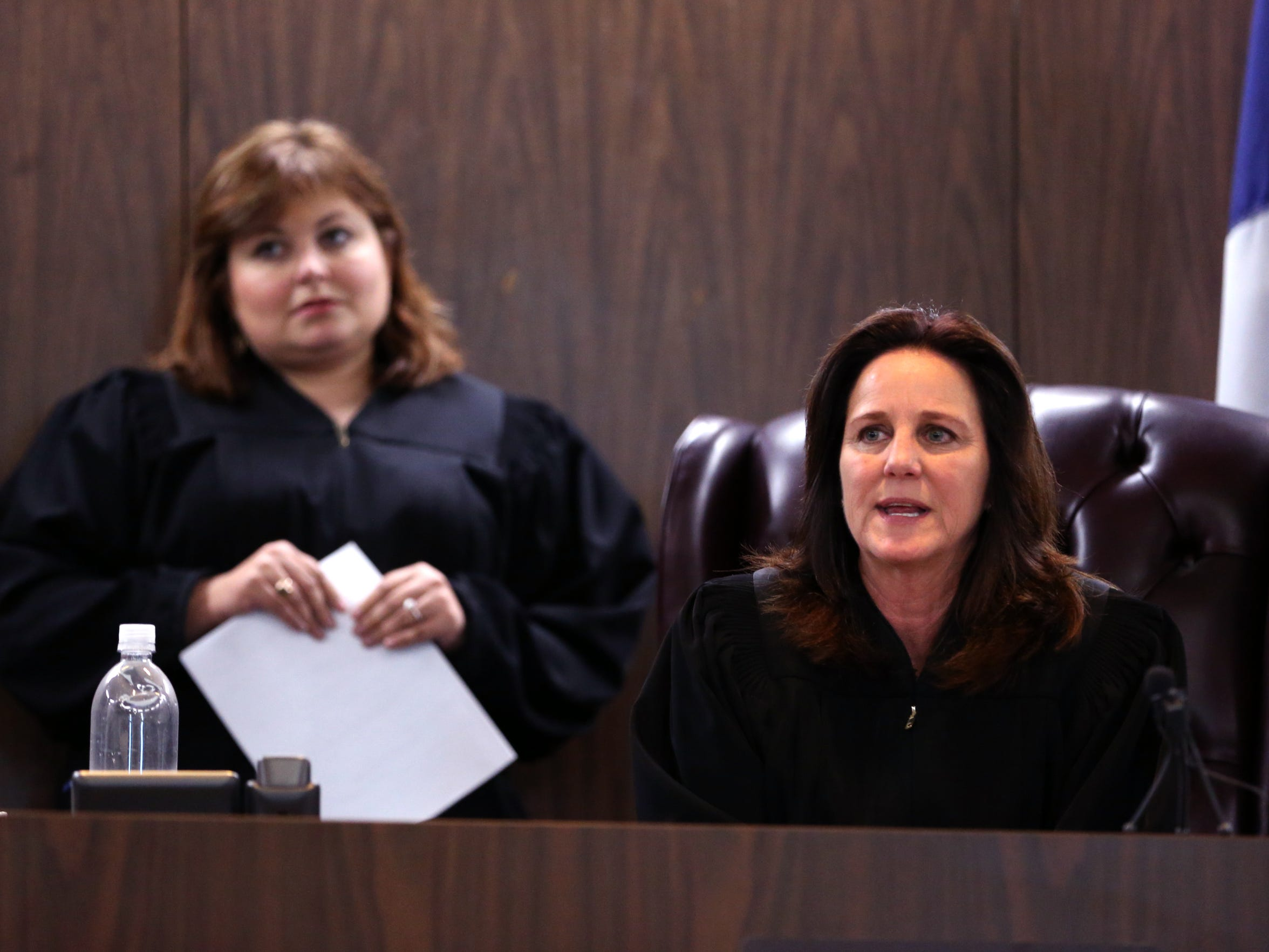 214th District Court Judge Inna Klein (left) prepares to take over the domestic violence court from 347th District Court Judge Missy Medary on Friday, April 14, 2017. During Klein's first probation review as judge of the domestic violence court, she sent 21 of 83 probationers to jail.