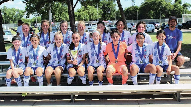 The NEOFC Bartlesville 2006 girls soccer team recently captured the championship in a major tournament in Broken Arrow. Front row, from left -- Chloe Shahan, Riley Waits, Lexi Smith, Aubrie Jones, Eva Sigler, NaDean Stamps, Carolina Amador and Marissa Walsh; back row, from left -- Ava Carter, Ashleigh Walker, Lauren Shoesmith, Grace Long, Shannon Suter, Ashlyne Johnson, Kinzie Doss and assistant coach Guido Gomez. Not shown are player Morgan Wasemiller and head coach Jordan Belong.