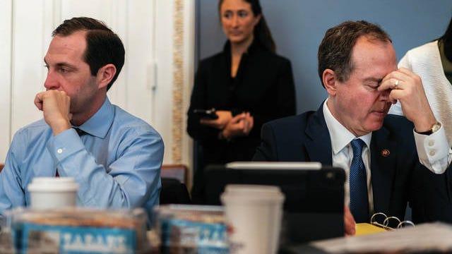 House Intelligence Chairman Adam Schiff, D-Calif., right, prepares for Senate impeachment proceedings Wednesday. Melina Mara / The Washington Post)