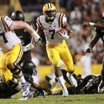 LSU Tigers running back Leonard Fournette (7) carries the ball in the second half against the Texas A&M Aggies at Tiger Stadium.