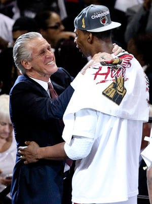 Heat President Pat Riley celebrates with star Chris Bosh after the 2012 championship.
