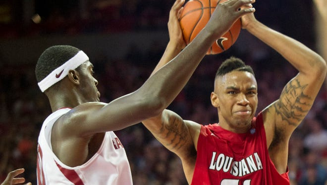 UL forward Shawn Long (21) pulls down a rebound over Arkansas Razorback forward Bobby Portis (10) during the second half of a game at Arkansas in 2013.
