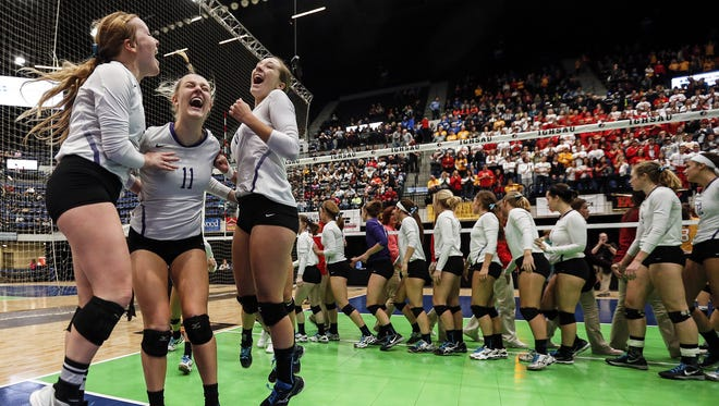 Nevada celebrates after winning a Class 3A state semifinal against Carroll Kuemper Thursday, Nov. 12, 2015.