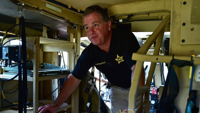 Rankin County Sheriff Bryan Bailey stands inside a new Mine-Resistant Ambush Protected armored vehicle.