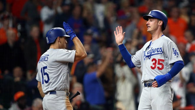 Los Angeles Dodgers first baseman Cody Bellinger and catcher Austin Barnes are two of many MLB connections to Arizona this season.
