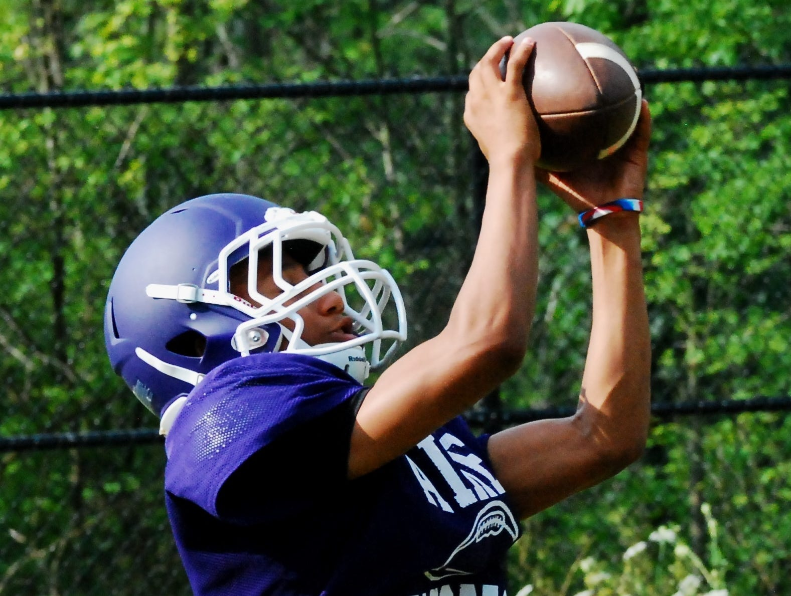 Aiken sophomore receiver Dequan Freeman looks in a completed pass for a score during 7-on-7 practice.
