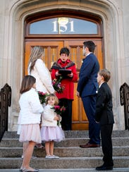 Lisa and Kyle Clark get married on the steps of City