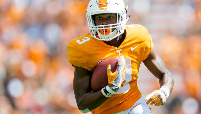 Tennessee running back Ty Chandler (3) runs down field during Tennessee's game against UMass in Neyland Stadium on Saturday, Sept. 23, 2017.
