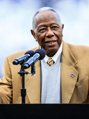 Former Braves slugger Hank Aaron speaks during a 2014 ceremony at Turner Field in Atlanta honoring the 40th anniversary of his record-breaking 715th home run.