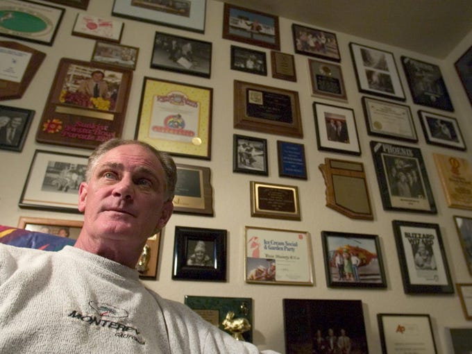 Channel 10 weatherman Dave Munsey sits in his office