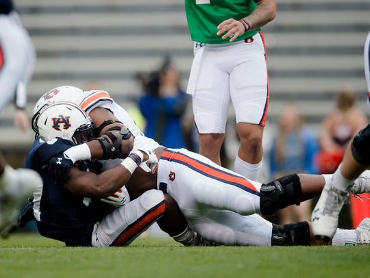Auburn wide receiver Nate Craig-Myers (3) is tackled