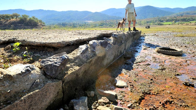Jeff LaLande checks out the foundation of the old Klamath Junction highway service station inundated 54 years ago by Emigrant Lake, Friday Oct 3, 2014.