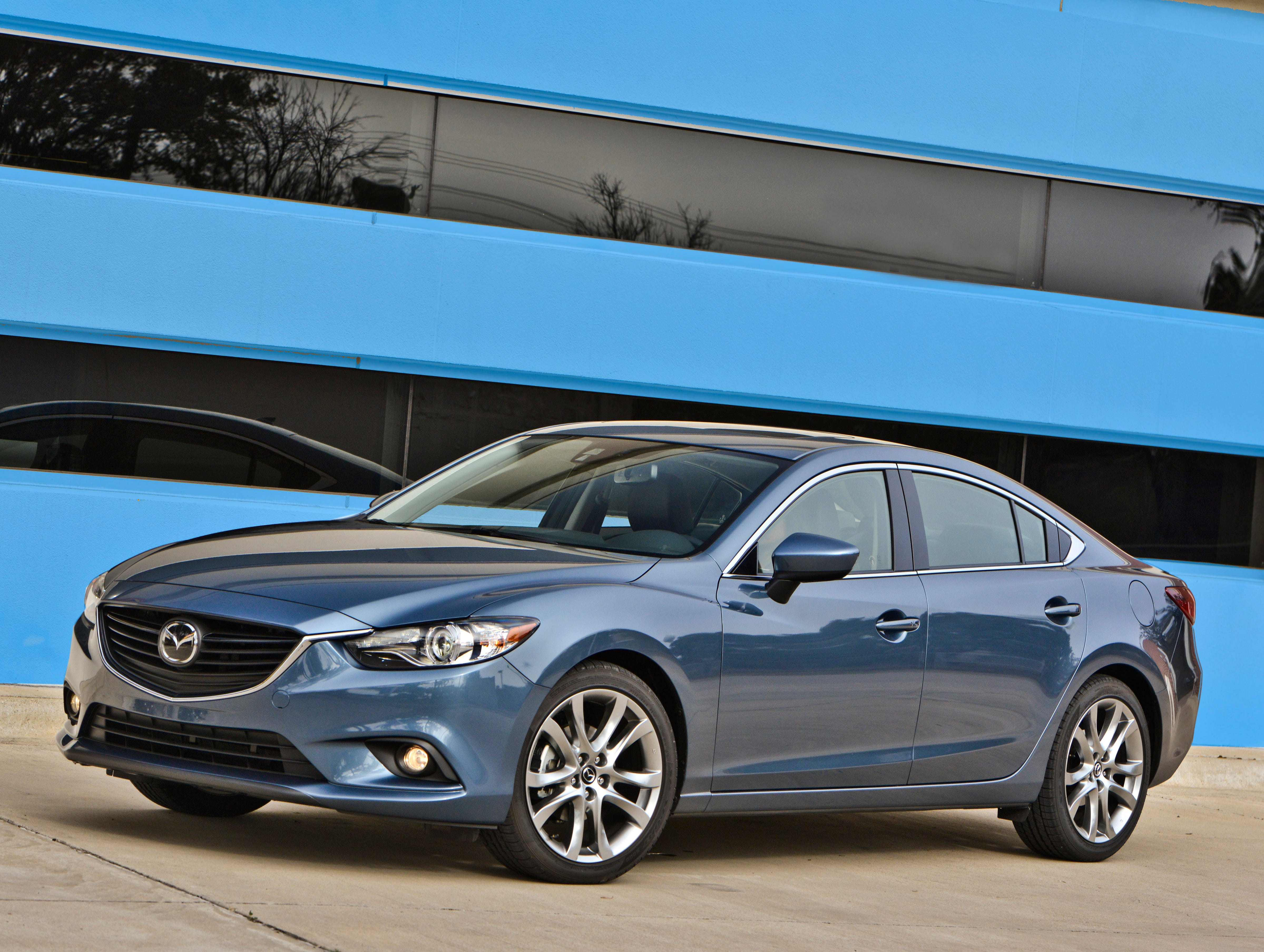 "Stylists softened the front end of the new Mazda6, toning down the exaggerated ""smile"" mouth on the previous model."