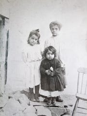 Jennie Truncale, center, at three years old with her