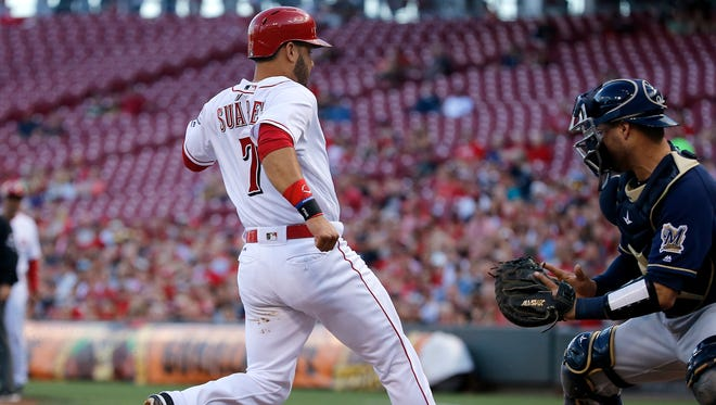 Cincinnati Reds third baseman Eugenio Suarez (7) scores in the first inning during the National League baseball game between the Milwaukee Brewers and the Cincinnati Reds on June 27, 2017 at Great American Ball Park.