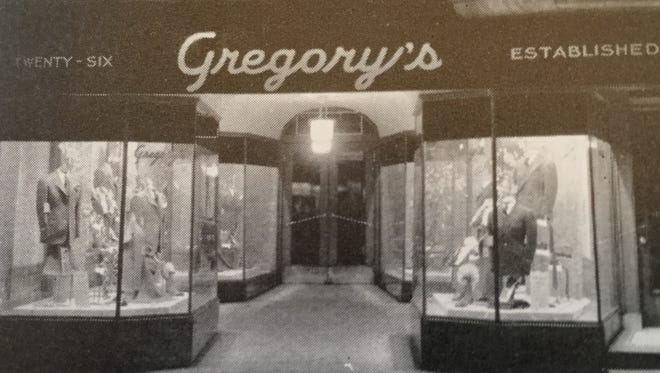 A photograph from around 1946 shows the display windows and entry to Gregory's Men's Store in the first block of North George Street.
