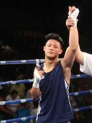 Coachella's own Brandun Lee,  wearing blue gloves, won his championship bout against Tony Narro during the 14th Annual Desert Showdown held at Fantasy Springs Resort Casino on July 18, 2015.