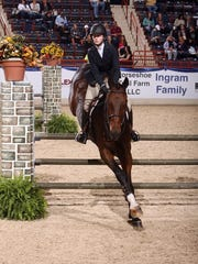 Carter Anderson competes at a horse show with Fedelio.