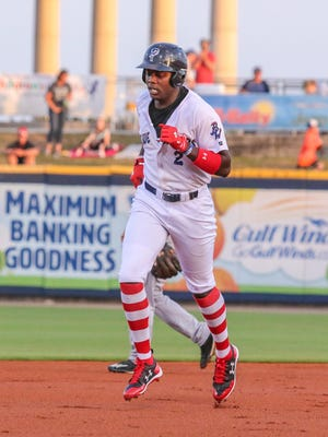 Pensacola's Aristides Aquino (2) makes his way around the bases after hitting a two-run home run against the Jacksonville Jumbo Shrimp at Blue Wahoos Stadium on Thursday, April 20, 2017