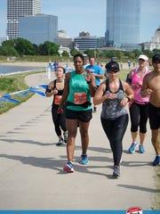 Ronetta Watson (center) runs the half marathon of the