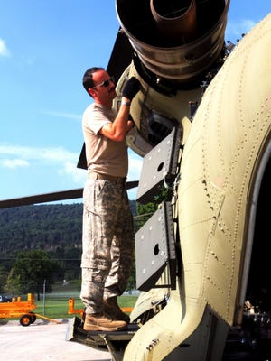 Chief Warrant Officer 4 Eric Ridilla, a maintenance test pilot with Company B, 628th Aviation Support Battalion, Pennsylvania Army National Guard, performs final checks on a CH-47 Chinook September 26, 2017 at Fort Indiantown Gap, Pa., before a flight mission to Puerto Rico in support of Hurricane Maria relief efforts.
