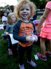 "Amilynn, 2, wears a Halloween ""Peanuts"" shirt during"