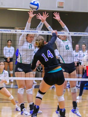 West Florida's Katy Kuhlmeier (17) and Rachel Neblett (13) try to block a shot by Shorter's Annie Homan (14) during the Gulf South Conference semifinal volleyball game at UWF on Saturday, November 18, 2017.  The Argos won the match in three straight sets and will play for the conference championship at tomorrow at 2 p.m. at the UWF Field House.