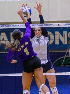 West Florida's Jordyn Poppen (5) denies a shot by North Alabama's Jessica Austin (1) in the Gulf South Conference volleyball championship game at UWF on Sunday, November 19, 2017. After losing to UNA in the conference championship game the previous two years, UWF beat their nemesis in three straight sets (25-19, 25-13, 25-17).